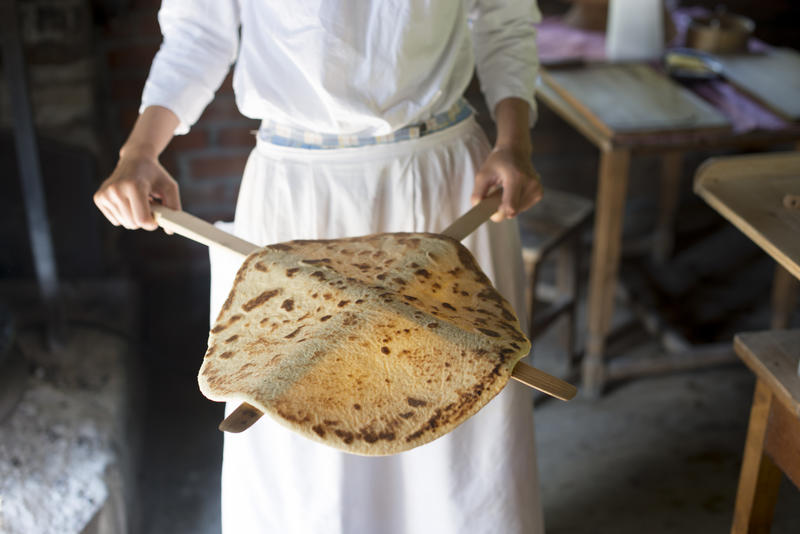 Woman showing a traditional baked lefse