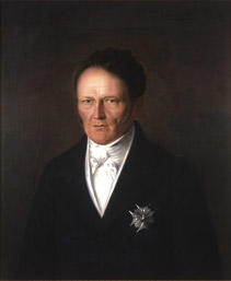 Portrett av Frederik Motzfeldt. Mørk drakt, Dannebrogsorden.