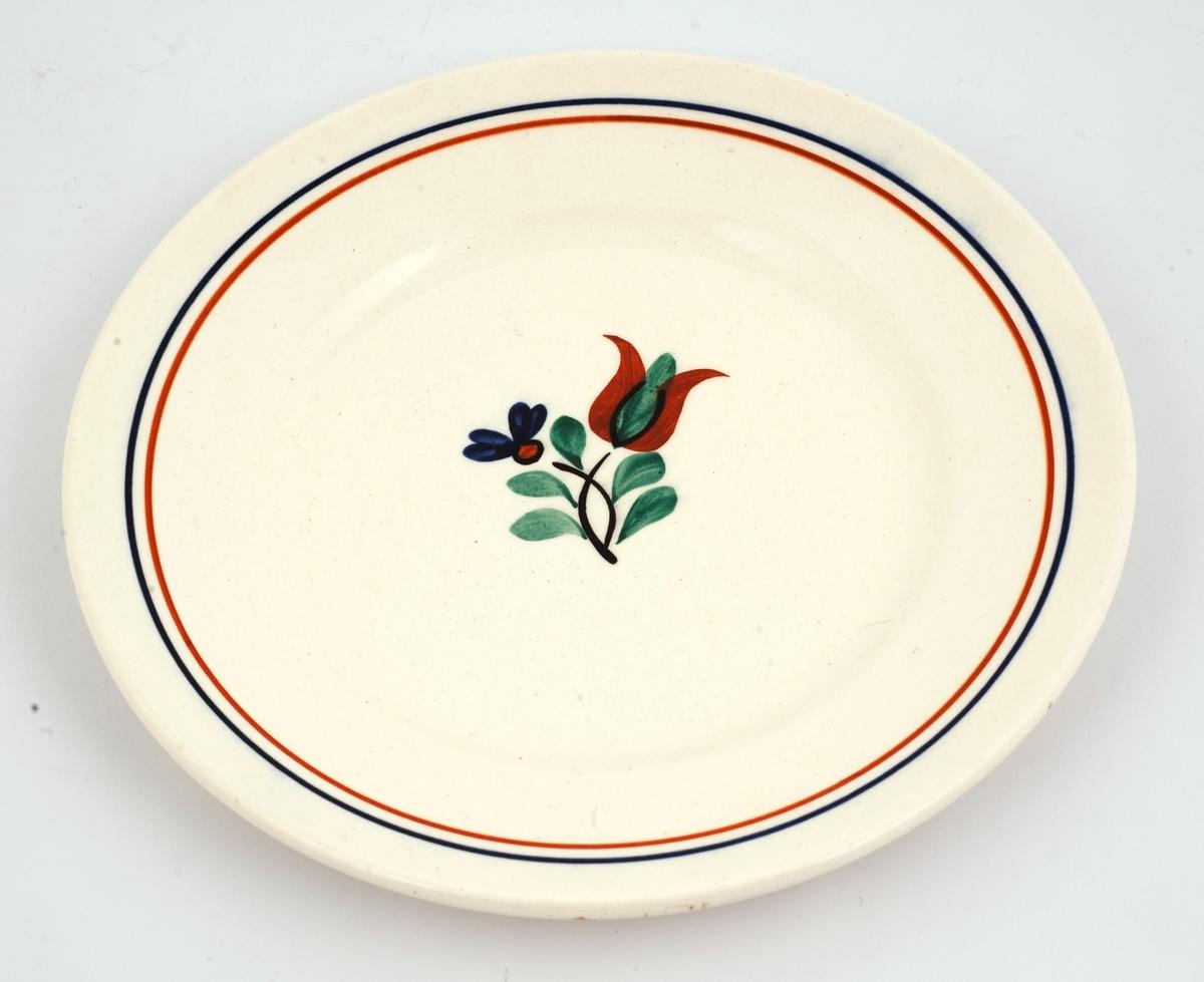 Frokostservise: 6 asjetter. Hvitt flintgods. Glasert og med malte dekorasjoner med blomstermotiv.