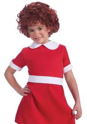 Annie; ei barnehjemsjente med rød kjole og rødt, krøllete kort hår.