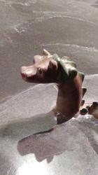 Sjøormen stikker hodet opp av Mjøsa på modellen fra Hamarkaupangen. (Foto/Photo)