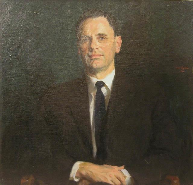 """Porträtt i olja av generaldirektör A.E.V Swartling.  Duken är fäst på en träplatta. En mässingsskylt med text: """"A.L.V. Swartling Generaldirektör 1947-1964"""" tillhör."""