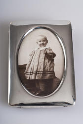 """This first item is a framed photograph of Kirsten Flagstad as a young girl. Even as a 1-year-old, the musicality had begun to show and she called herself """"Titten Tangerin"""", or Kirsten Singer. Maja Flagstad and Michael Flagstad, her parents, were renowned musicians in Kristiania. This pictures is taken in 1896 and is a part of a series of family photos."""