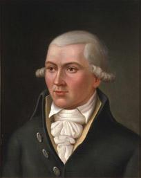 Portrett av Hans C U Midelfart. Grått hår (parykk), mørk kjol (jakke), gul vest, hvit skjorte og halstørkle. (Foto/Photo)