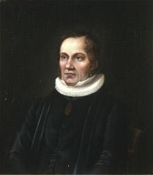 Portrett av Laurentius Oftedal. Prestekjole og -krave. Medalje eller medaljong i bånd rundt halsen.