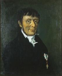Portrett av Carl Stoltenberg. Mørk drakt, hvit skjorte og halsbind. Orden på venstre side av brystet. (Foto/Photo)
