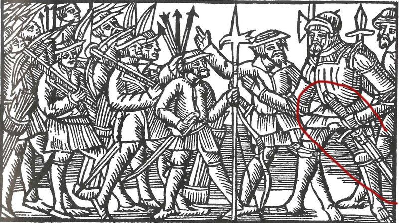"""Illustrasjon fra Olaus Magnus' """"Historia om de nordiske folken"""": """"Futen måtte myndig instruere sine menn, hvis han vaklet ville han være i livsfare"""". Illustrasjonen viser flere menn med armbrøster og hellebarder, samt futen i rustning med en hånd på sitt tohåndssverd, som sitter i sliren."""